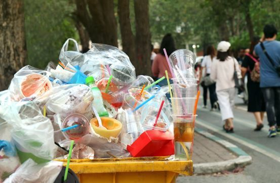 Plastics piled up in a bin